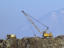 Landfill reclamation. Landfill slag heap environmental reclamation project with truck and shovel Royalty Free Stock Images