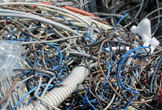Landfill of refuse with pieces of demolished old electric cables. Landfill of refuse with pieces of demolished electric cables stock photo
