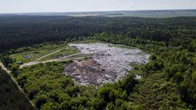 Landfill removal of unsorted debris in the middle of the forest. Aerial photography with drone royalty free stock photos
