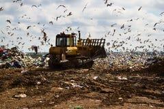 Landfill rubbish bulldozers processing garbage Royalty Free Stock Image