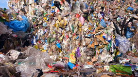 Landfill site, urban refuse dump. Lots of plastic, waste garbage collected in cubes. 4K stock video