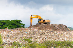 Landfill truck working on dumpsite Stock Photo
