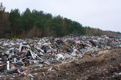 Landfill in Ukraine, piles of plastic dumped in . The roads along inorganic waste jumble. Landfill in Ukraine, piles of plastic dumped in piles. The roads along Royalty Free Stock Photography