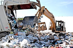 A landfill site. A landfill in the waste management cycle is a place where urban solid waste and all other even damp waste generated by human activities are stock image