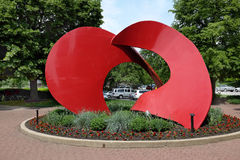 Landforms Sculpture. NAPERVILLE, ILLINOIS - MAY 26, 2017: Landforms Sculpture. The artwork by Jack Arnold is in the Naperville Riverwalk. The riverwalk follows Royalty Free Stock Images