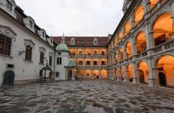 Landhaus courtyard with a bronze fountain at sunset. Graz, Austria royalty free stock photo