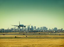Landing. A plane lands in JFK airport Stock Photography