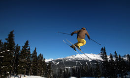 Landing. A skier coming in for a landing in Whistler, BC Stock Image