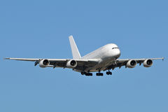 A380 Landing. An Airbus A380 landing at an airport Stock Photo