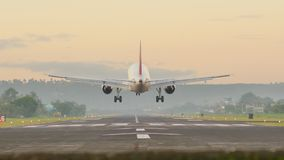 Landing aircraft at the airport of the city of Legazpi early in the morning. Philippines. stock photos