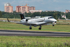 Landing aircraft at the airport in Rostov-on-Don. Embraer-135 makes a landing, Rostov-on-Don, Russia, July 15, 2015 Stock Photo