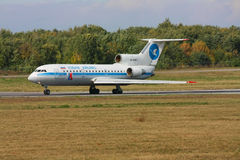 Landing aircraft at the airport in Rostov-on-Don. The Yak-42 aircraft is accelerating before take-off, Rostov-on-Don, Russia, October 13, 2010. The plane of the Royalty Free Stock Images