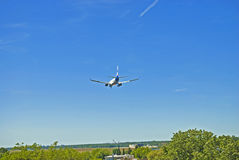 Landing aircraft. Boeing 737 landing at Tegel airport in Berlin, Europe Stock Photography