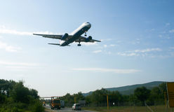 Landing aircraft, Montenegro royalty free stock photography