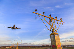 Landing aircraft over landing lights Stock Image
