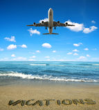 Landing an aircraft on a tropical island Stock Photo