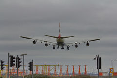 Landing. An airliner comes in to touchdown in the evening Royalty Free Stock Photo