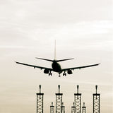 Landing airplane. At sun set Royalty Free Stock Image