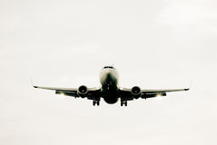 Landing airplane. Airplane landing at sun set Stock Photography