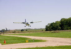 Landing Airplane. This is an medium sized twin engine plane landing on a grass landing strip Royalty Free Stock Photos