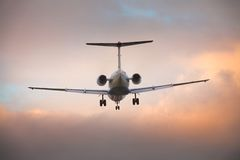 Landing airplane Stock Images