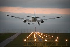 Landing airplane stock photography