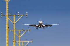 Landing. Airplane landing at an airport royalty free stock photography