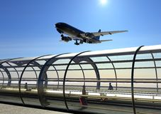 Landing airplane and airport terminal Stock Photo