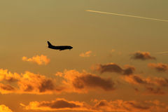 Landing of airplane in Prague (Ruzyne), sunset Stock Photography