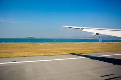 Landing. Airplane is landing in runway Royalty Free Stock Image