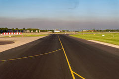 Airplane Landing on Airport Runway - Cabin View Royalty Free Stock Photo