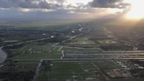 Landing at amsterdam international airport AMS january 2018. Heading from city to sea stock video