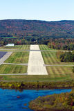 Landing approach. Cockpit view of short landing strip at Pittsfield, Mass., municipal airport on an autumn afternoon Royalty Free Stock Images