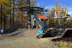 Landing area on chair lift in autumn mountain forest Stock Photos