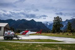 Landing area with helicopter in mountains stock photos