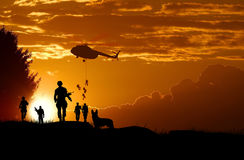 Landing of Army soldiers at sunset Royalty Free Stock Photo
