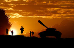 Landing of Army soldiers at sunset Stock Image