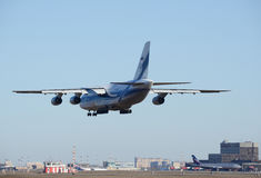 Landing of the big airliner. Stock Photo
