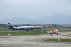 Landing of Boeing 777-3M0 (VP-BGC) Aeroflot at the airport Noi Bai. Hanoi, Vietnam Royalty Free Stock Photography