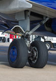 Landing gear. Of airplane in airport Royalty Free Stock Photo