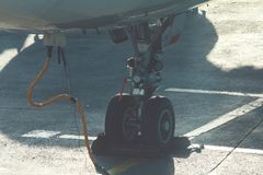 Landing gear of airplane in airport, preparing for take-off stock image
