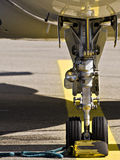 Landing gear of an airplane. Closeup photo of a medium size business jet landing gear Royalty Free Stock Photo