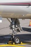 Landing gear of an airplane. Closeup photo of a medium size business jets landing gear Royalty Free Stock Photos