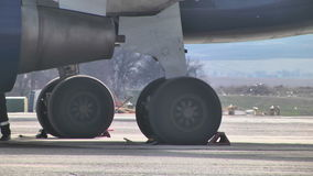 Landing gear on the runway. Boeing 747 at the airport stock video footage