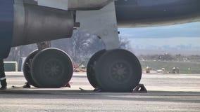 Landing gear on the runway stock video footage