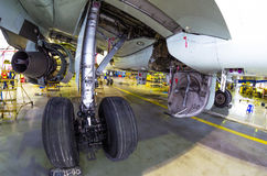 Landing gear under the wing in the hangar Royalty Free Stock Images