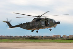 Landing helicopter Stock Images