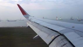 Landing at Hong Kong airport stock footage