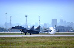 Landing jet killing speed parachute Stock Photography