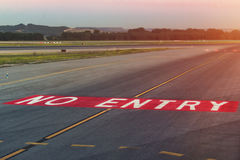 Landing light. Directional sign markings on the tarmac of runway at a commercial airport Royalty Free Stock Photography